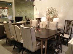 Hoff Miller's Valentines Day display with 140-70 Arisan Chamfered Corner Dining Table - Ash; 150-01 Surry Arm Chair; 2350-01 Sebastian Arm Chair; 150-02 Martin Host Side Chair armless in ash with loose cushion; and 6172-11 Marlboro Side Chair made by Hickory Chair Company.