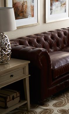 Wrapped in richly hued top-grain leather upholstery, this Chesterfield-inspired sofa adds a touch of handsome style to your living room or den. Get this at jossandmain.com