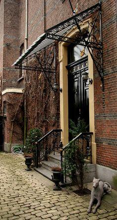 Belgian doorway - look at that iron door canopy awning - love it