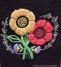 A Window of Many Flowers by Christine McCollum.  2014 Tucson Quilters' Guild, photo by Quilt Inspiration.  Floral block design by Leora Raikin.