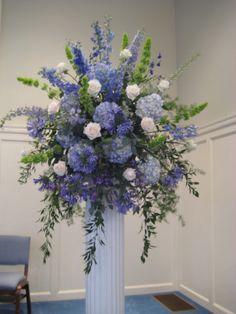 Hydrangea, Delphinium, Bells of Ireland, Agapanthus blue reception funeral flowers