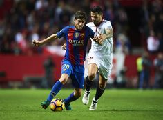 "Sergio Roberto of FC Barcelona (L) competes for the ball with Victor Machin Perez ""Vitolo"" of Sevilla FC (R) during the match between Sevilla FC vs FC Barcelona as part of La Liga at Ramon Sanchez Pizjuan Stadium on November 6, 2016 in Seville, Spain."