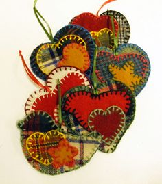 Christmas ornaments made from wool fabric scraps by Judy Standerford.