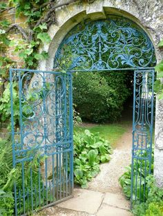"""Paint Colors for Iron Gates and Fences"" by Kendra Wilson . This glorious gate is in the garden at Rousham, near Oxford. ""The color used here is Prussian blue. Such a color is found occasionally on century ironwork. Garden Gates And Fencing, Fence Gate, Garden Path, Cacti Garden, Shade Garden, Garden Entrance, Garden Doors, Entrance Gates, Garden Archway"