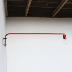 Swing-arm wall lamp