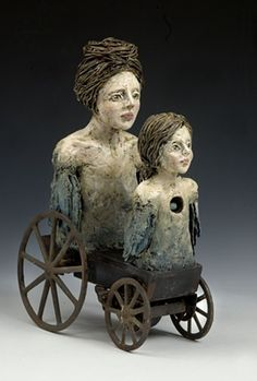 """Elissa Farrow Savos, Ceramic Sculpture and Found Object, 8""""x22""""x49"""", 2015 Savos continues her 'Mother and Child' theme in this work.  One thing I love to do is to combine toys into artwork.  This use of a wagon as the base works well to represent the movement of life.  Why does the child have a hole in his chest?  Is that something the mother has to fill?"""