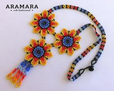 Dimentions Lenght 11 inches cms) Diameter of each flower is 2 inches cms) The Huichol r Flower Necklace, Boho Necklace, Huichol Art, Stock Flower, Beaded Banners, Mexican Jewelry, Beaded Choker, Beaded Necklaces, Handmade Beaded Jewelry