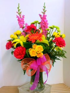 Enter to win a free Spring Flower Arrangement for Liking our Facebook page!