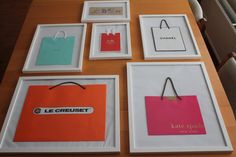 Framed designer shopping bags. Perfect for decorating a wall.
