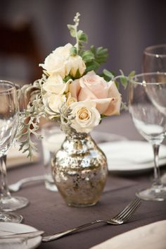 LOVE this vase and pale colors - i'd do peonies rather than roses though...