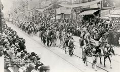 Calgary stampede parade.  Entertainment included the Cisco Kid, Jay Sister and his performing sheep dogs, clown Fess Reynolds with his African Lion, Joaquin Sanchez and his trick mule.