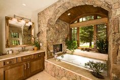 51 Mesmerizing master bathrooms with fireplaces THIS BATHTUB ENCLOSURE HAS EVERYTHING I COULD EVER WANT - BRICK, BIG WINDOWS, SOAKER TUB, A FIREPLACE - JUST GORGEOUS.