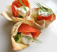 Baked wonton wrappers. You can fill them with different cheeses,meats or smoked salmon. Brilliant and beautiful!
