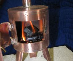While looking at camp stoves I thought that I needed a tiny one. This is a wood burning (tea Light Alternative) miniature camp stove. The stove is made from scrap copper tubing and about 3 hours of my time. I used 2 5/8 copper tube and basic copper plumbing tube. all connections are brazed using my Smith Mini Torch. When completed It will boil water and keep going for up to 25 minutes. All that is missing is a laser etched maple leaf