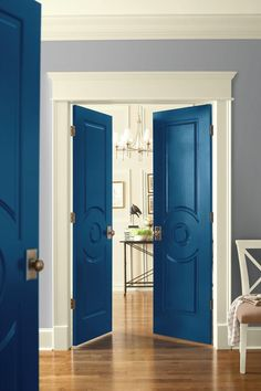 Dont be afraid to make a statement with color! Remember, its only paint -- a design decision that you can easily update as your taste changes. We love these bold doors painted in BEHRs Star Spangled blue!