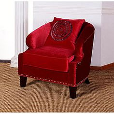 Enhance your home decor with a red velvet club chair  Chair is voluptuous and playfully snazzy  Living room furniture is made of stunning red velvet