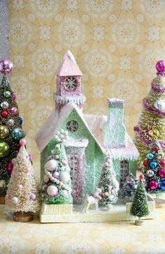 Frost covered wintery village house plus glittering trees - so festive!