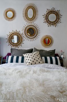 Paris designer Virginie Manivet's bedroom. She found the 1960s sunburst mirrors at antiques markets in the south of France.