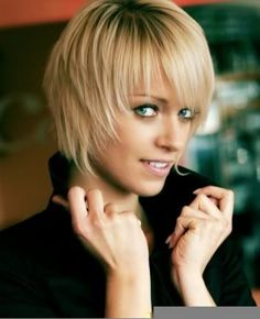 Very Short wispy  layered hair style with wispy bangs blonde