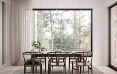 Dining room Scandinavian style decor and interior with wishbone chairs