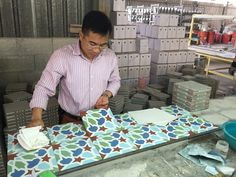 Last check cement tile before packing. #Encaustic handmade cement tile , #Saigon tiles, #Hanoi cement tile , #traditional cement tiles , #vietnam cement tile, #floor cement tile, #walling tile, indoor tiles, kitchen tiles, #hydraulic cement tiles , patterned tiles, #pressed cement tiles , #morocco tile
