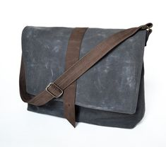 Introducing the Sloane Waxed Canvas Messenger Bag - clean, classic style with an elegant sensibility and the practical durability of water-resistant waxed canvas. An elegant take on an everyday crossbody bag - the Sloane can fit a small laptop, small work portfolio, tablet - as well as wallet, keys, pens, small notebooks and your other daily odds and ends.  Features: - Adjustable leather strap for crossbody or over-the-shoulder wear (image #4) - Flap closure, secured with metal stud/butt...