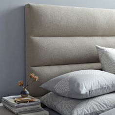 Panel-Tufted Headboard | west elm. Shows idea of horizontal upholstered panels. In application these would be wider and higher to create the oversize upholstered headboard.