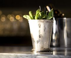 Mint julep in a silver cup --recipe at link (we use mint-infused simple syrup, tho)