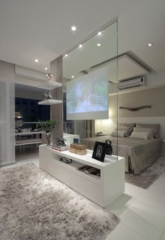 Modern contemporary luxury white master bedroom with TV inside a glass panel ! Sexy, cool and wonderful! Double bedroom dream house luxury home house rooms bedroom furniture home bathroom home modern homes interior penthouse Tv In Bedroom, Master Bedroom Design, Master Bedrooms, Bedroom Furniture, Furniture Plans, Bed Room, Luxury Master Bedroom, Master Suite, System Furniture