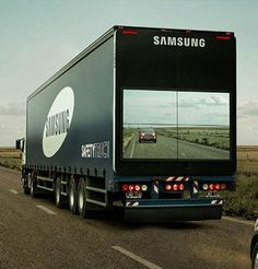 The Samsung Safety Truck features a wireless camera mounted on the front and a display on the back, showing the road ahead. The move is a part of an effort to reduce head-on collisions from cars trying to pass.