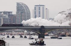 A steam train and pleasure boat of all shapes and sizes are seen from Battersea bridge on the River Thames as the Queen celebrates her Diamond Jubilee