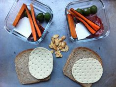 A lunchbox cocktail party with crudités, cheese, and olives.