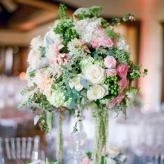 Centerpieces from Junebug's Real Weddings Library | Photo: Troy Grover Photographers | Floral design: Elegant by Design