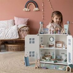 Available the beginning of October! This classic doll's house guarantees loads of play fun. The sturdy wooden frame has cute blue… Wooden Dollhouse, Wooden Dolls, Imagination Toys, Blue Roof, Blue Shutters, Bed In Closet, Roof Panels, Large Pillows, Softies