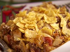 Food Network invites you to try this Tortilla Casserole recipe from Sandra Lee.