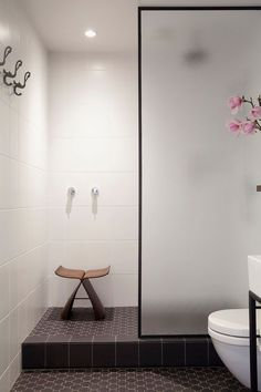 Bathroom Design Idea - Black Shower Frames | The black frame around the frosted glass door of this shower adds a simple sophistication to the space and ties together the other black elements in the room.