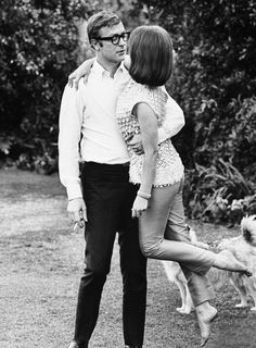 Michael Caine sweeping Natalie Wood off her feet photographed by Billy Ray, 1966.