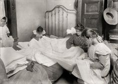 "November 1912. New York. ""Family cutting embroidery in tiny crowded bed-room."" Glass negative by Lewis Wickes Hine for the National Child Labor Committee"