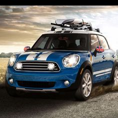 Blue White Countryman-I LOVE my mini, and i want another....4 doors taking the sports car to the family