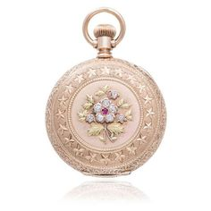 Peter Suchy rose, yellow and green gold pocket watch with rubies, diamonds and an enamel dial, circa 1890s.