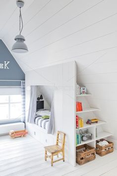 Love this idea for a room with angled ceilings. Great cubby hole for kids and a nice use of storage space.