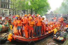 It's held on April 30th each year (or 29th if the 30th is a Sunday) and is a celebration of Queens Beatrix's birthday. In Amsterdam there's an outdoor concert for nearly 1 million people as the main focus of the celebrations but it generally involves wandering the streets dressed in orange, with orange dyed hair in what has been termed 'orange madness'.