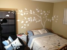 This simple silhouette of tree was easily painted on the wall with a mural from Elephants on the Wall. Pick a color - any color and you too can make it your own. (you could even repeat it someplace else!)