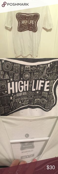 RARE miller high life t shirt Rare collectible miller high life t shirt. White with black design. Says size large but it fits more like a fitted tee shirt. Let me know if you have any other questions :) Vintage Tops Tees - Short Sleeve