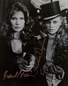 GREAT SHOT FROM THE 1983 JAMES BOND FILM OCTOPUSSY 8 X 10 PHOTO SIGNED IN PERSON BY MAUD ADAMS (OCTOPUSSY) AND KRISTINA WAYBORN (MAGDA)