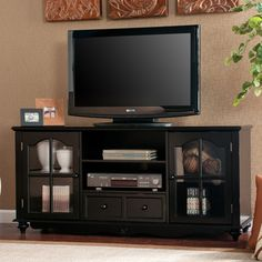 @Overstock.com   Reduce Clutter And Add Storage With This Sleek Black Media  Cabinet