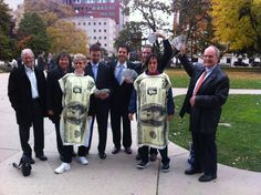 VIDEO: Represent.US stages fake money drop onto floor of Michigan State House of Representatives to protest money in politics | Eclectablog