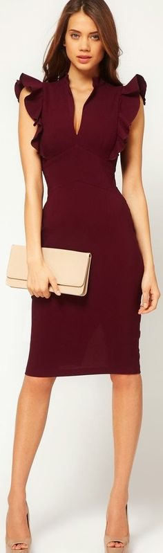 Just love the colour. Flattering burgundy dress with ruffles shoulders