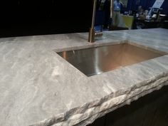 Sky White quartzite with a leathered finish. No substitute for the allure of natural stone!