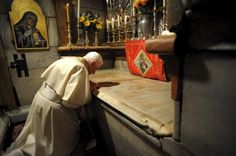 Benedict prays in 2009 at the site where Jesus is traditionally believed to be buried, inside the Church of the Holy Sepulcher in Jerusalem.